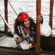 Actor in the guise of Jack Sparrow on a sailing ship gangway Castor-1 — Stock Photo #8522387