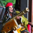 Actor in the guise of Jack Sparrow with a gun on a sailing ship — Stock Photo #8522448