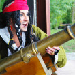 Actor in the guise of Jack Sparrow with a gun on a sailing ship — Foto Stock