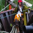 Stock Photo: Actor in guise of Jack Sparrow on his nose sailing ship Castor-1
