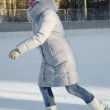 A girl in winter sports clothing on ice skates, ice skating — Stock Photo #8781883