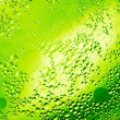 Drops of oil on green water — Foto de stock #10580361