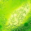 Stock Photo: Drops of oil on green water