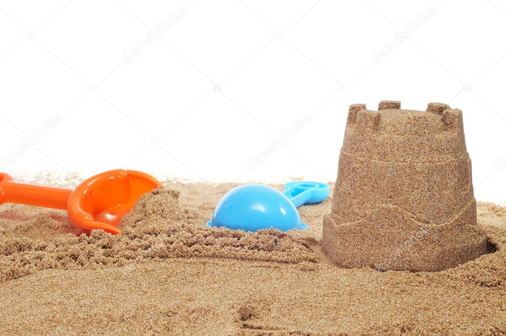 Sandcastle and beach shovels on a white background — Zdjęcie stockowe #10000284