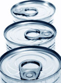 Closeup of a pile of cans on a white background — Foto Stock
