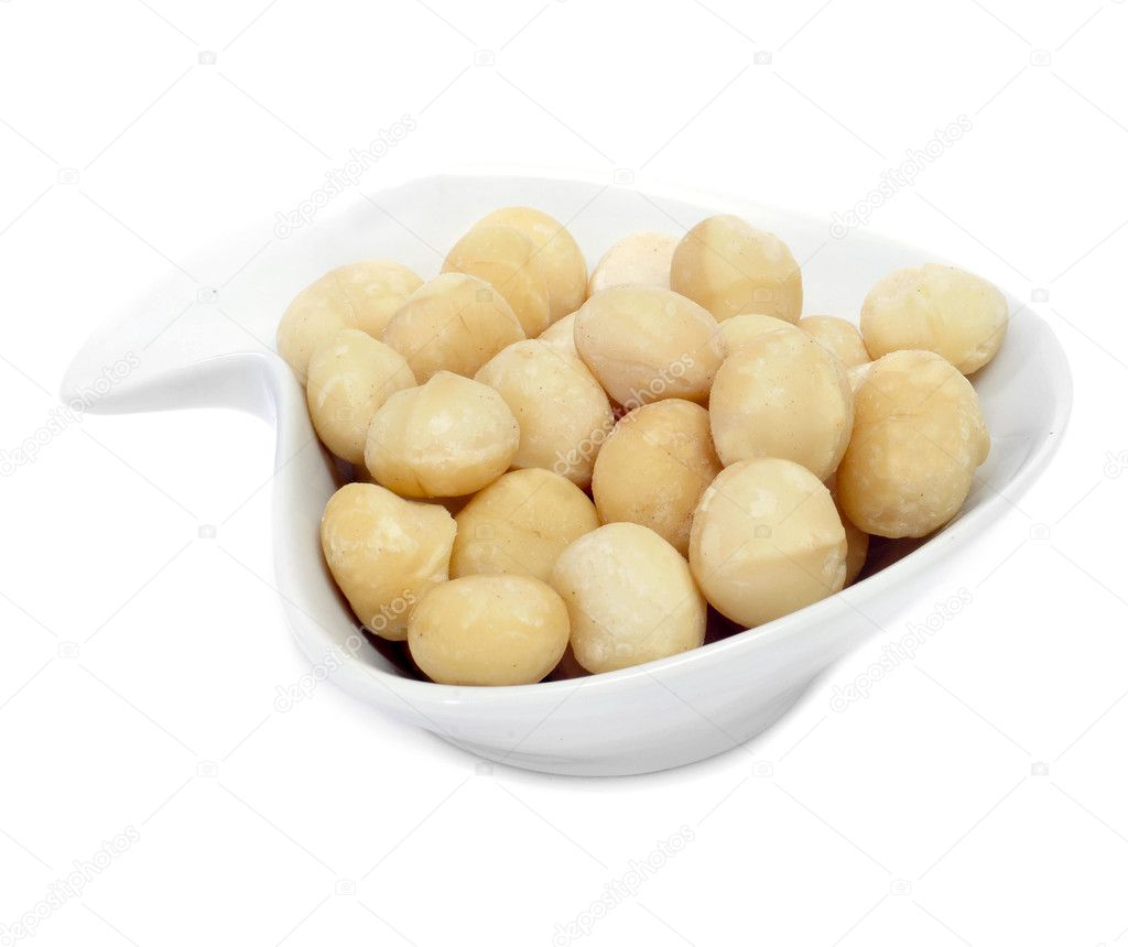 A bowl with macadamia nuts on a white background — Stock Photo #8421502