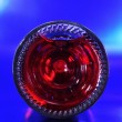 Bottom of a red sparkling wine bottle — Stock Photo #8536679