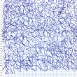 Scribbles on a checkered paper sheet — Stock Photo