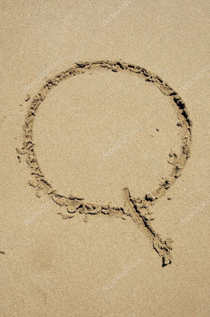 Q letter written in the sand of a beach  Stock Photo #9969589