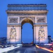 The Arc de Triomphe by night - Stock Photo
