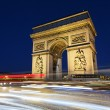 Arc de Triomphe and car lights - Stock Photo