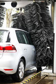 Grey car during washing process — Stock Photo