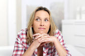 Pensive blond woman — Stock Photo