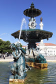 Famous fountain on rossio square — Stock Photo