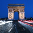 Famous Arc de Triomphe by night — Stock Photo