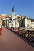 Church and footbridge — Stock Photo