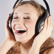 Pretty woman listening, and enjoying music — Stock Photo