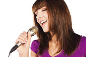 Happy young woman singing with microphone — Stock Photo