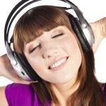 Pretty woman listening, and enjoying music — Stock Photo #10226324