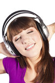 Pretty woman listening, and enjoying music — Stock Photo