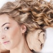 Stock Photo: Beautiful young womwith long curly hair
