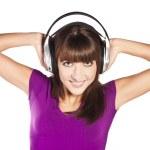 Pretty woman listening, and enjoying music — Stock Photo #10244466
