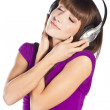 Pretty young woman listening music — Stock Photo #10331194