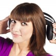 Pretty young woman listening music — Stock Photo #10331201