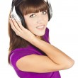 Pretty young woman listening music — Stock Photo #10331417