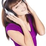 Pretty woman listening, and enjoying music — Stock Photo #10331419