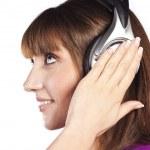 Pretty woman listening, and enjoying music — Stock Photo #10331430
