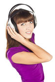 Pretty young woman listening music — Stock Photo