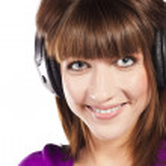 Pretty woman listening, and enjoying music — Stock Photo #10345935