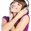 Pretty young woman listening music — Stock Photo #10360427
