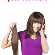 Attractive smiling woman brushing her hear — Stock Photo #10541948
