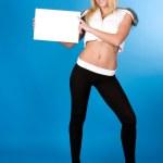 Portrait of a beautiful woman holding a blank billboard — Stock Photo #9069731