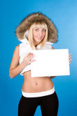 Closeup portrait of cute young woman holding a white page — Stock Photo