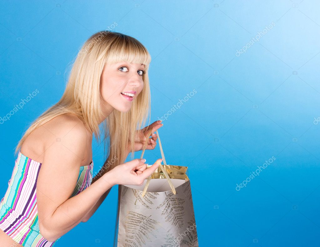Happy woman with shopping bag over blue — Stock Photo #9069922