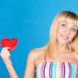 Woman holding Valentines Day heart sign with copy space — Stock Photo #9070027