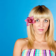 Young pretty girl with flower in hair portrait — Stock Photo #9070524
