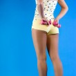 Back of sportswoman holding dumbbells — Stock Photo #9075926