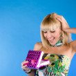 Young girl surprised gift. In the studio — Stock Photo #9076664