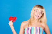 Woman holding Valentines Day heart sign with copy space — Stock Photo