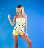 Beautiful blonde in a yellow sports clothing — Stock Photo