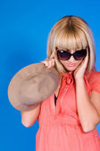 Blonde in glasses a blue background — Stockfoto