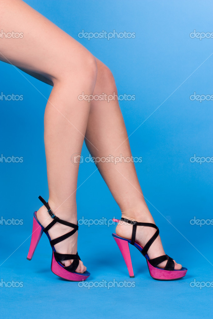 Sexy legs of beautiful woman isolated on blue — Stock Photo #9070882