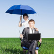 Happy businessmen working on laptop. Outdoors on a sunny day — Stock Photo