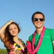 Photo: Young love Couple smiling under blue sky