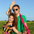 Stock Photo: Young beautiful happy couple on field. street