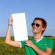 Young happy student holding form — Stock Photo